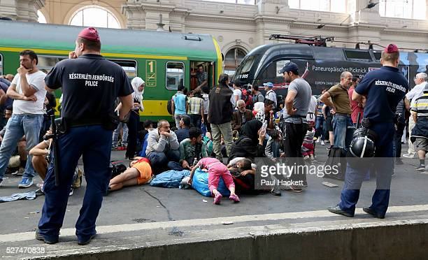Migrants wait on the platform Keleti train station in Budapest Hungary September 3 2015 An estimated 3000 people were believed to be camped out at...