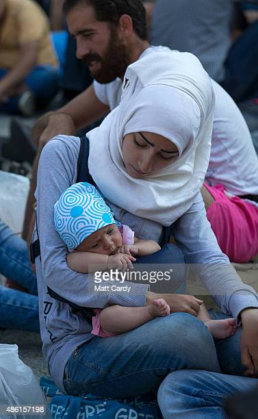 Migrants wait outside Keleti station in central Budapest after it was closed to migrants earlier today on September 1 2015 in Budapest Hungary The...