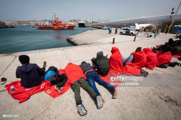 Migrants wait to be assisted by the Spanish Red Cross at the Port of Tarifa southern Spain on June 23 2018 A total of 418 migrants were rescued in...