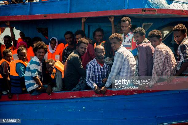 Migrants wait to be rescued by the Aquarius rescue ship run by nongovernmental organisations 'SOS Mediterranee' and 'Medecins Sans Frontieres' in the...