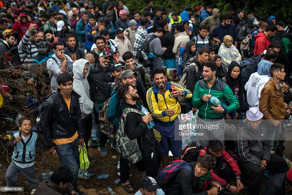Migrants wait to cross into Croatia through the Serbian border on September 25, 2015 in Bapska, Croatia. More than 40,000 migrants have crossed into Croatia from Serbia since Tuesday last week. The Croatian government said on Wednesday it can not cope with this increasing number of migrants crossing its border and that Serbia should be also moving people on to Hungary and Romania. European Union ministers agreed on Tuesday to relocate 120,000 refugees among EU member states to ease the migration pressure on nations such as Greece and Italy.