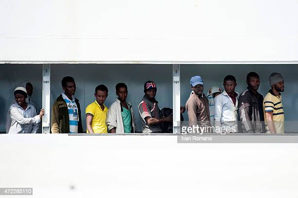 Migrants wait to disembark at Salerno from military ship 'Bettica' following a rescue operation at sea on May 5 2015 in the port of Salerno southern...