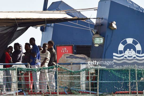 Migrants wait to disembark from the German NGO Sea Watch3 ship on November 8 2017 in the Sicilian harbour of Pozzallo During a shipwreck five people...