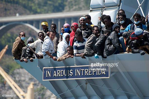 Migrants wait to disembark from the Italian Navy vessel 'Chimera' in the harbor of Salerno on April 22 2015 in Salerno Italy The Italian navy brought...