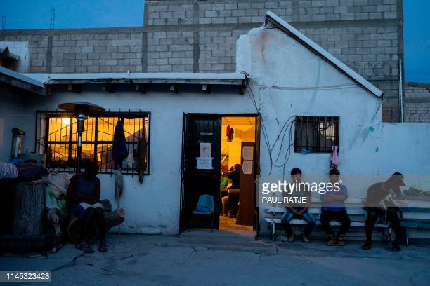 Migrants waiting to enter the United States are pictured at dusk at Iglesia Metodista El Buen Pastor a church run shelter for migrants where they are...