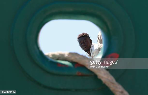 A migrants waits to disembark from the Spanish Guardia Civil Rio Segura Patrol Ship with 1216 migrants onboard including 256 children and 11 pregnant...