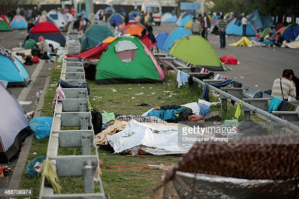 Migrants wake up from tents to a more peaceful morning after the previous day's friction at the border crossings on September 17 2015 in Horgos...