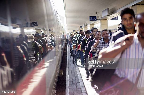 Migrants walk at a platform at Vienna's Westbahnhof train station in Vienna Austria on September 6 2015 after they have arrived by a train from...