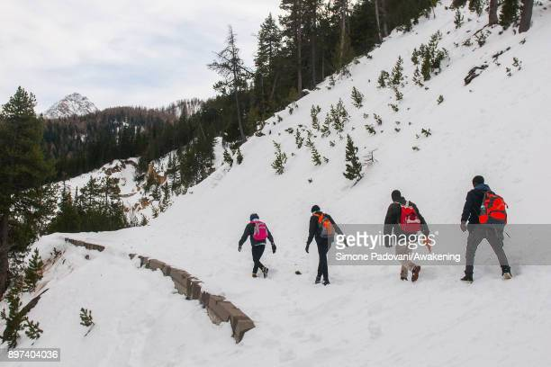 Migrants walk at Colle della Scala during another attempt to reach the French border on December 22 2017 in Bardonecchia Turin Italy After the police...