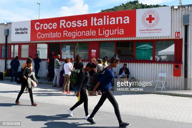 Migrants walk at the Italian Red Cross camp in Ventimiglia, northern Italy, on June 15, 2018.