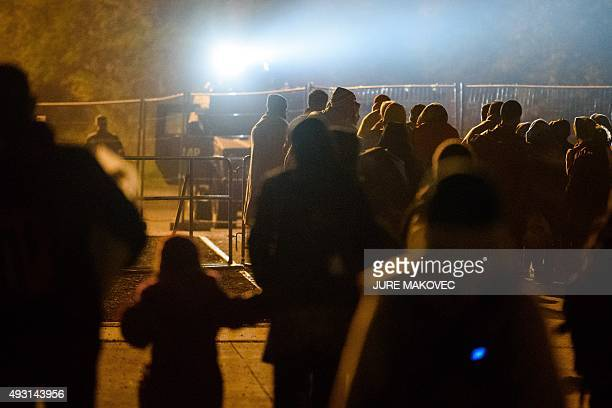 Migrants walk from Slovenian to the Austrian side of the border crossing between Sentilj and Spielfeld on October 18 2015 AFP PHOTO/JURE MAKOVEC