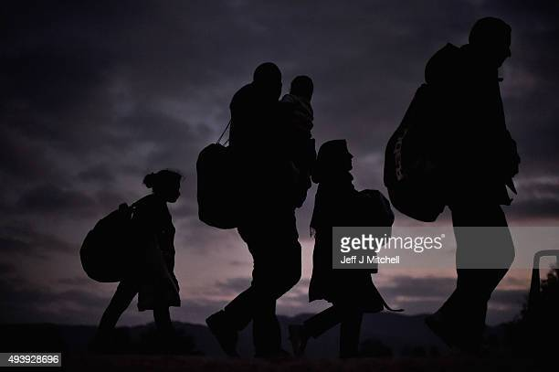 Migrants walk from the village of Rigonce to Brezice refugee camp in tha dark on October 23 2015 in Rigonce Slovenia Thousands of migrants marched...