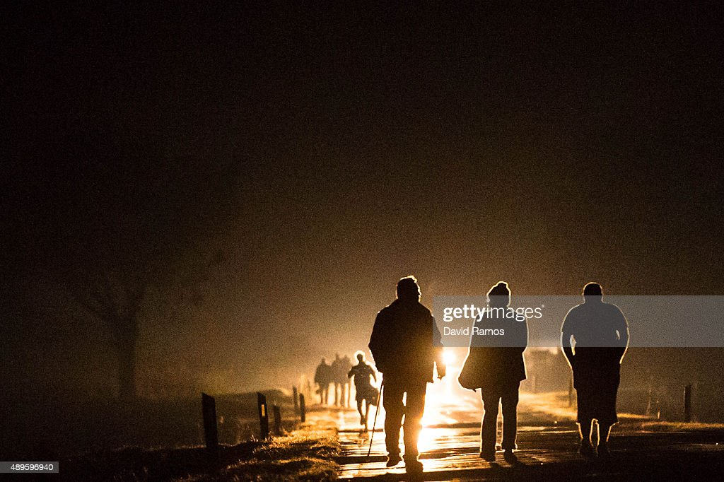 Migrants walk the last kilometres during the night towards a refugee camp after crossing the Croatian border with Serbia on September 22, 2015 in Opatovac, Croatia. Croatia has built a refugee camp to control the transit of migrants to Hungary with a capacity of 4,000 people. Thousands of migrants have arrived in Austria over the weekend with more en-route from Hungary, Croatia and Slovenia. Politicians across the European Union are to hold meetings on the refugee crisis with EU interior ministers meeting tomorrow and EU leaders attending an extraordinary summit on Wednesday.
