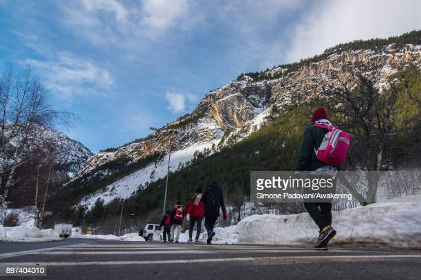 Migrants walk to reach Colle della Scala during another attempt to reach the French border on December 22 2017 in Bardonecchia Turin Italy After the...