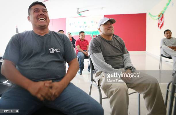 Migrants watch the MexicoSouth Korea World Cup match in the Salvation Army shelter for migrants on June 23 2018 in Tijuana Mexico The shelter houses...