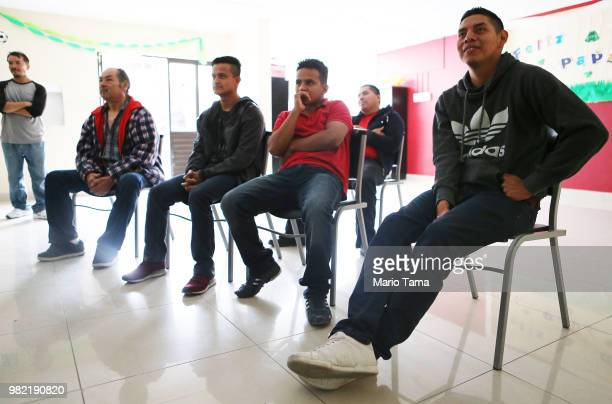 Migrants watch the MexicoSouth Korea World Cup match on a television in the Salvation Army shelter for migrants on June 23 2018 in Tijuana Mexico In...