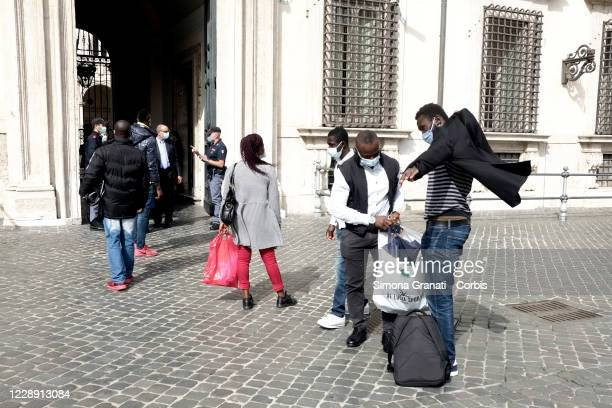 Migrants who are victims of exploitation receive a residence permit by Prime Minister Giuseppe Conte on October 5 2020 in Rome Italy Migrants entered...