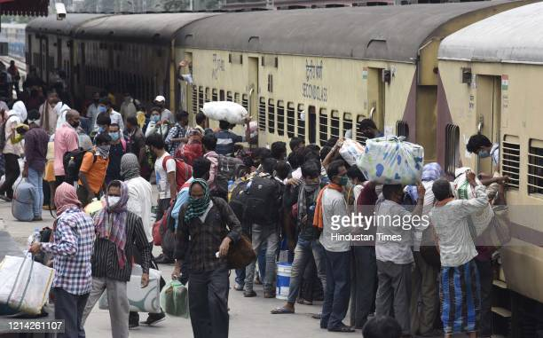 Migrants who arrived from Gujarat on a Shramik Special flouting social distancing as they rush to board a train arranged to transport them within the...