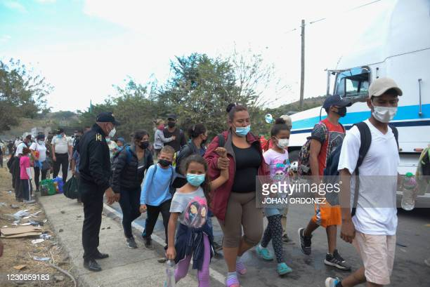 Migrants who arrived in caravan from Honduras on their way to the United States, are seen after security forces dispersed them in Vado Hondo,...