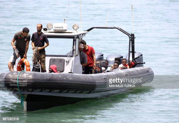 Migrants who survived the sinking of an inflatable dinghy boat off of the coast of Libya are brought ashore in alHmidiya east of the capital Tripoli...