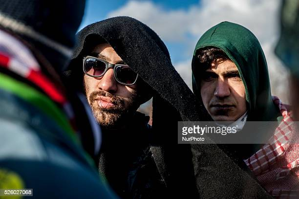 Migrants with sewn lips protest against the dismantling of the southern part of quotJunglequot migrant camp in Calais France on March 7 2016 A second...