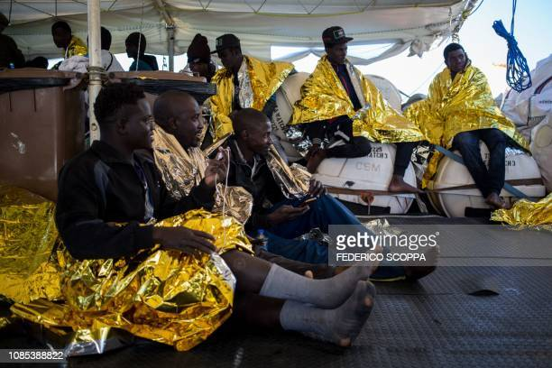 Migrants wrapped in survival blankets are pictured aboard the Dutchflagged vessel Sea Watch 3 after being rescued from an inflatable boat during a...