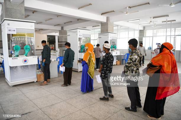 Migration workers seen waiting in a social distance queue in front of the sample collection booth to get tested for the COVID-19 infection at the...