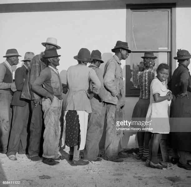 Migratory Workers waiting to Receive Supplies of Surplus Commodities Belle Glade Florida USA Marion Post Wolcott for Farm Security Administration...
