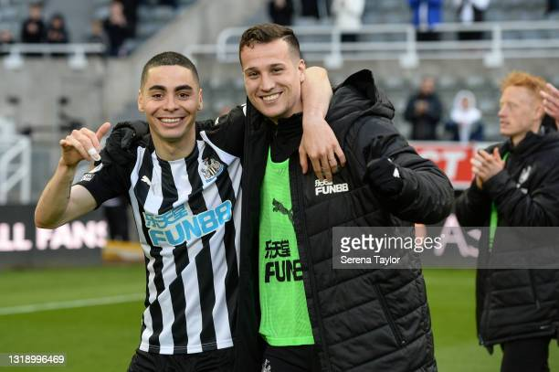Miguel Almirón of Newcastle United FC and Javier Manquillo pose for a photo on the pitch during the Premier League match between Newcastle United and...