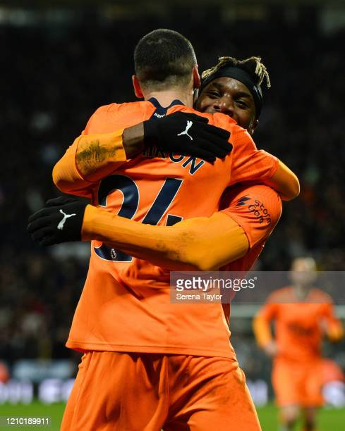 Miguel Almirón of Newcastle United FC celebrates with Allan SaintMaximin after scoring the opening goal during the FA Cup Fifth Round match between...