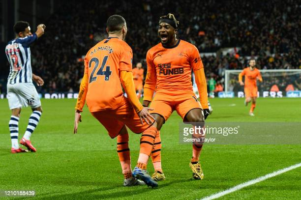 Miguel Almirón of Newcastle United FC celebrates with teammate Allan SaintMaximin after scoring the opening goal during the FA Cup Fifth Round match...