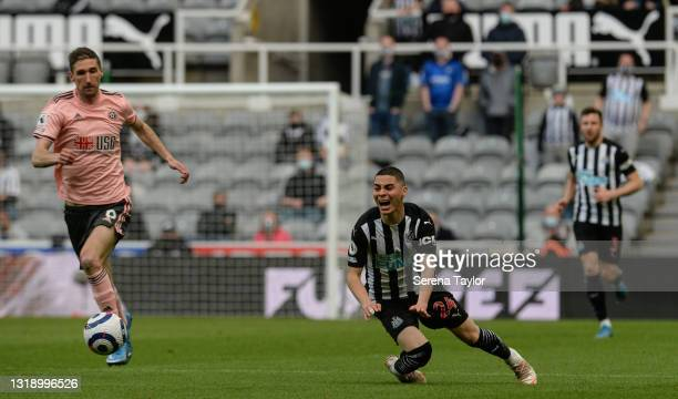 Miguel Almirón of Newcastle United FC is fouled during the Premier League match between Newcastle United and Sheffield United at St. James Park on...