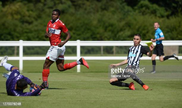 Miguel Almirón of Newcastle United FC strikes the ball and is saved by Middlesbrough FC goalkeeper Dejan Stojanović during the Pre Season Friendly...