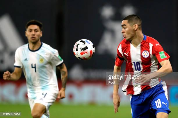 Miguel Almirón of Paraguay controls the ball against Gonzalo Montiel of Argentina during a match between Argentina and Paraguay as part of South...