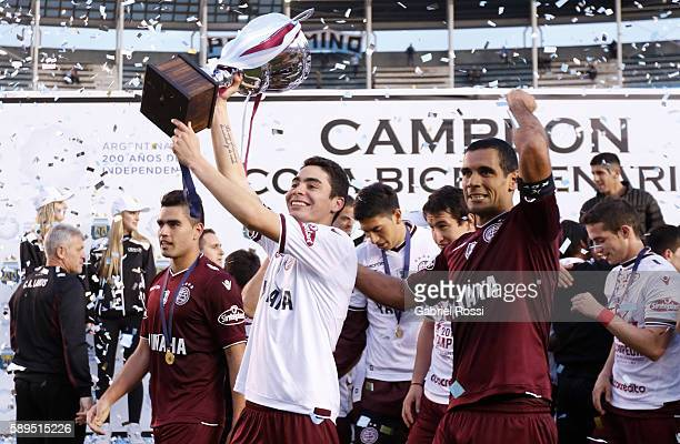 Miguel Almiron and Jose Sand of Lanus celebrate after winning the match between Racing Club and Lanus as part of Copa del Bicentenario de la...