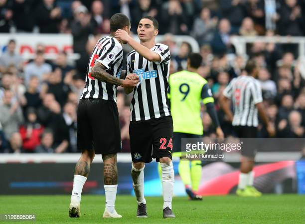 Miguel Almiron and Kennedy of Newcastle together during the Premier League match between Newcastle United and Huddersfield Town at St James Park on...