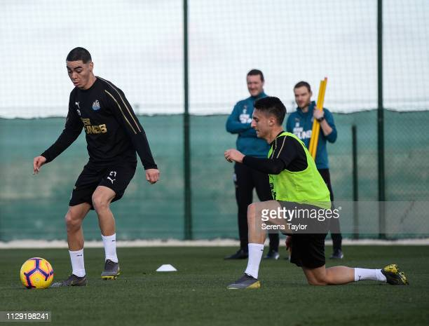 Miguel Almiron controls the ball whilst Antonio Barreca looks to close him down during the Newcastle United warm weather training session at La Finca...