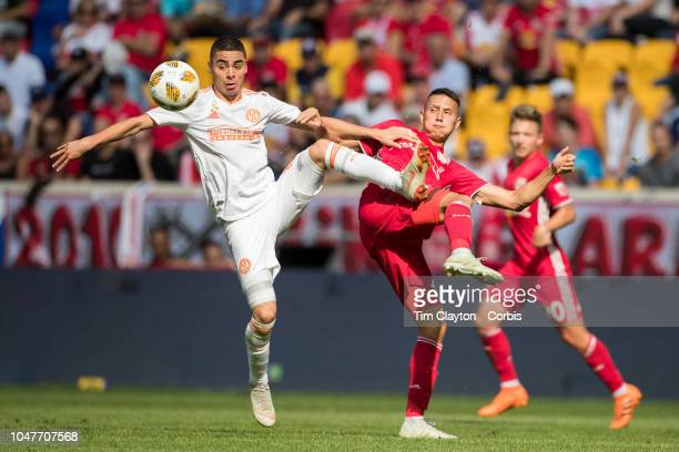 Miguel Almiron of Atlanta United and Sean Davis of New York Red Bulls challenge for the ball during the New York Red Bulls Vs Atlanta United FC MLS...