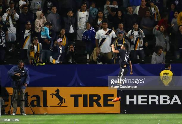 Miguel Almiron of Atlanta United celebrates after scoring on a penalty kick in extra time of the second half as Los Angeles Galaxy fans look on...