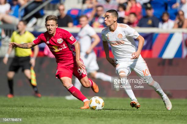 Miguel Almiron of Atlanta United challenged by Marc Rzatkowski of New York Red Bulls during the New York Red Bulls Vs Atlanta United FC MLS regular...