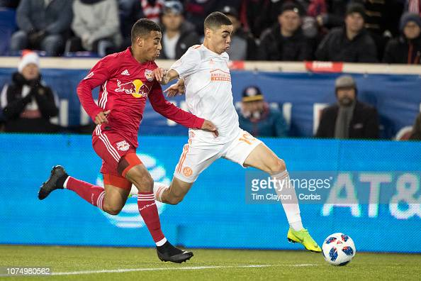 Miguel Almiron Of Atlanta United Challenged By Tyler Adams
