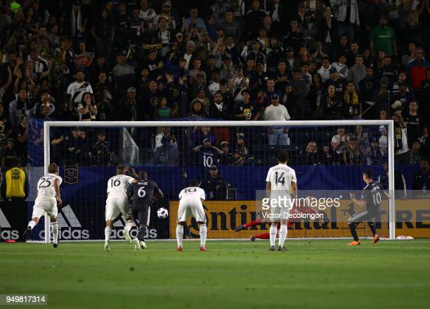 Miguel Almiron of Atlanta United converts the penalty kick and scores in extra time against goalkeeper David Bingham of Los Angeles Galaxy during the...
