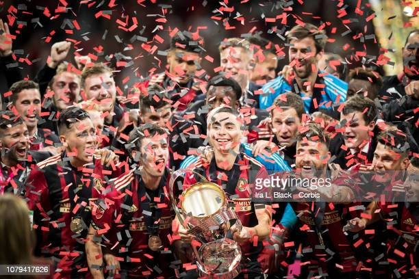 Miguel Almiron of Atlanta United holds the Phillip P Anschutz MLS Championship Trophy in celebration with other teammates after the 2018 Audi MLS Cup...