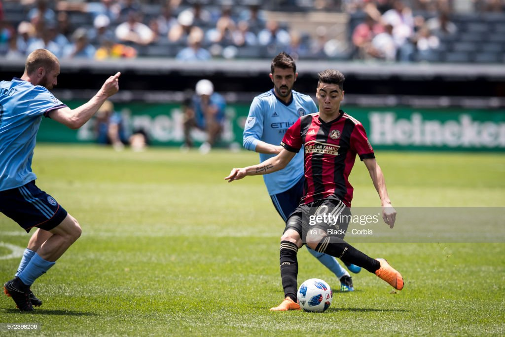 Miguel Almiron #10 of Atlanta United kicks the ball through NYCFC defense during the match between New York City FC and Atlanta United FC at Yankee Stadium on June 09, 2018 in the Bronx borough of New York. The match ended in a tie score of 1 to 1.