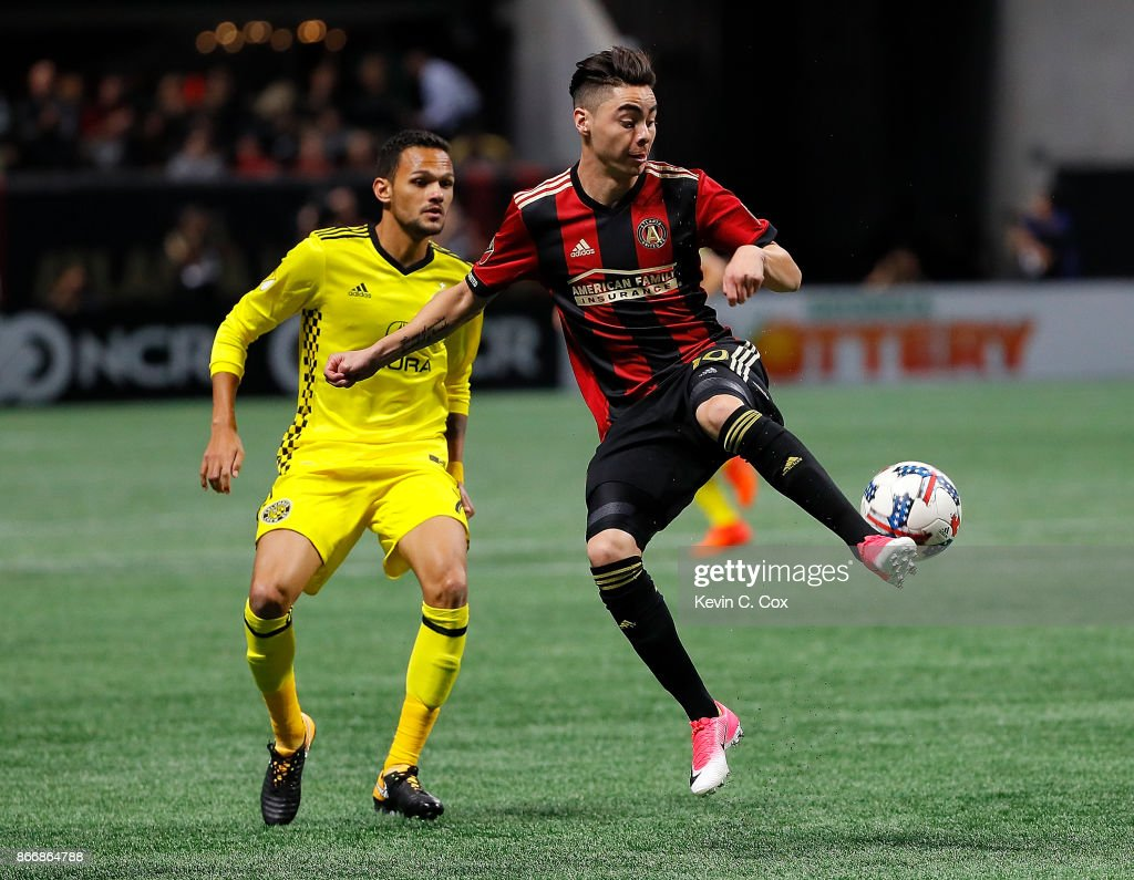 Miguel Almiron #10 of Atlanta United passes the ball against Artur #7 of Columbus Crew during the Eastern Conference knockout round at Mercedes-Benz Stadium on October 26, 2017 in Atlanta, Georgia.