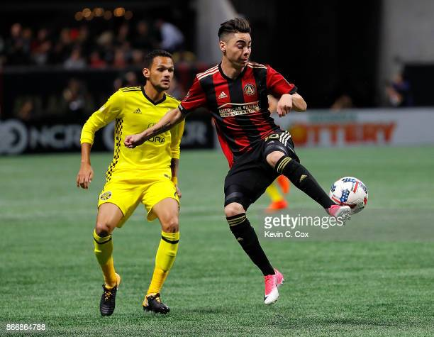 Miguel Almiron of Atlanta United passes the ball against Artur of Columbus Crew during the Eastern Conference knockout round at MercedesBenz Stadium...