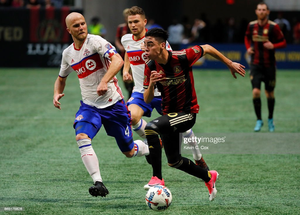 Miguel Almiron #10 of Atlanta United pushes the ball against Michael Bradley #4 of Toronto FC at Mercedes-Benz Stadium on October 22, 2017 in Atlanta, Georgia.