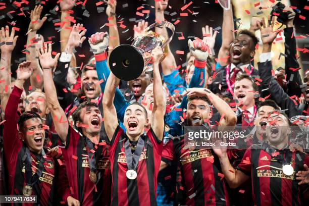 Miguel Almiron of Atlanta United raises the Phillip P Anschutz MLS Championship Trophy in celebration with other teammates after the 2018 Audi MLS...