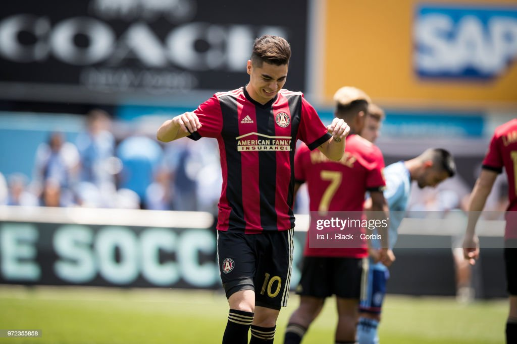 Miguel Almiron #10 of Atlanta United tries to brush off an injury to his shoulder during the MLS match between New York City FC and Atlanta United FC at Yankee Stadium on June 09, 2018 in the Bronx borough of New York. The match ended in a tie score of 1 to 1.