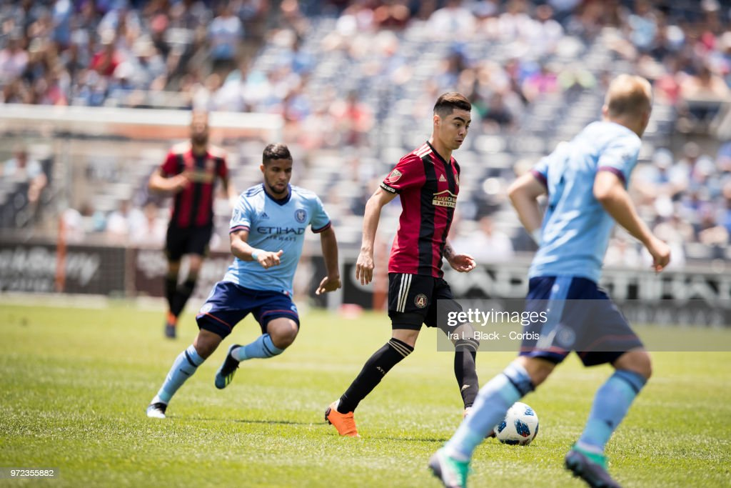Miguel Almiron #10 of Atlanta United tries to weave through NYCFC defenders during the MLS match between New York City FC and Atlanta United FC at Yankee Stadium on June 09, 2018 in the Bronx borough of New York. The match ended in a tie score of 1 to 1.